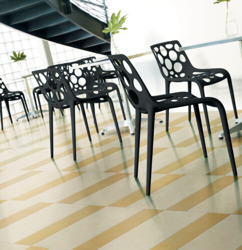 ARGENT INSTALLED IN A LOBBY WITH BLACK TABLES AND CHAIRS