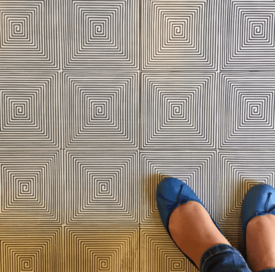 MIRTH TILE LUX PATTERN WITH A PERSON STANDING